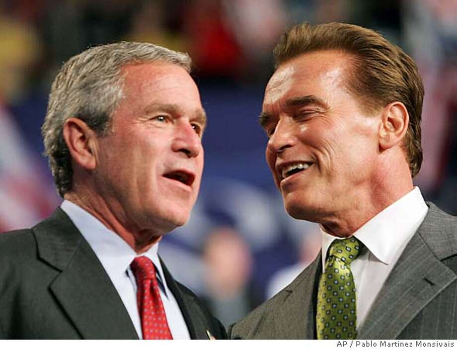 President Bush, left, is introduced by California Gov. Arnold Schwarzenegger at a campaign rally Friday, Oct. 29, 2004 in Columbus, Ohio. (AP Photo/Pablo Martinez Monsivais) Photo: PABLO MARTINEZ MONSIVAIS