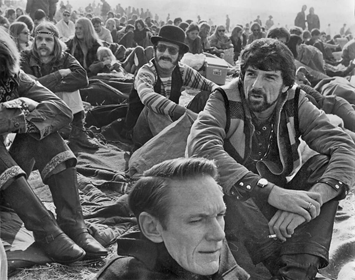 Thom Gunn (right) his partner Mike Kitay (center in derby hat) at Altamont rock concert 1969. Gunn and Kitay were partners for 52 years until Gunn's death in 2004.