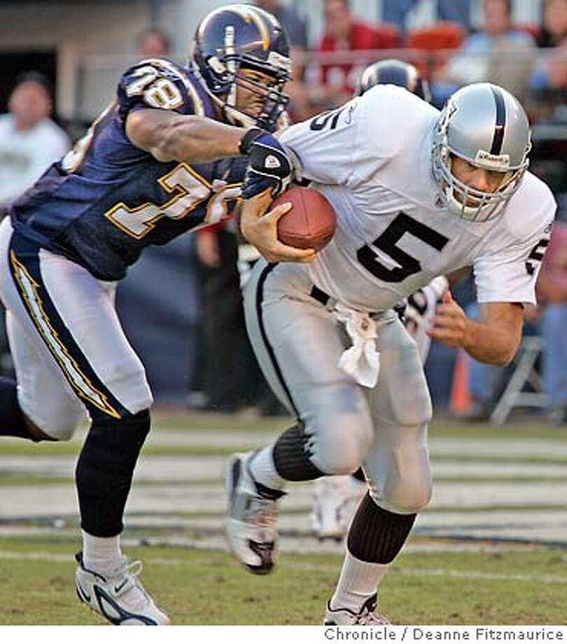 Kerry Collins is sacked in the 4th quarter. Oakland Raiders vs San Diego Chargers at Qualcomm Stadium in San Diego.  Deanne Fitzmaurice / The Chronicle Photo: Deanne Fitzmaurice