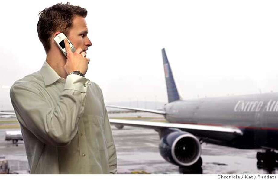 AIRCELL28025_RAD.JPG News feature that anticipates possible government OK to use personal cell phones in airplanes during flight. Photo shows Travis Johnson of Illinois in SFO making a call on his cell just after he missed his flight to Chicago. Photo taken on 4/27/05, in SFO, CA.  By Katy Raddatz / The San Francisco Chronicle MANDATORY CREDIT FOR PHOTOG AND SF CHRONICLE/ -MAGS OUT Photo: Katy Raddatz