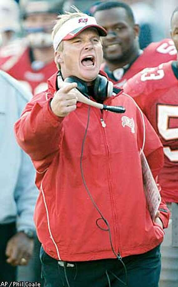 Tampa Bay Buccaneers coach Jon Gruden reacts yells from the sideline during their NFC divisional playoff game against the San Francisco 49ers in Tampa, Fla., Sunday, Jan. 12, 2003. Gruden doesn't want to hear about the Buccaneers' pathetic past in Philadelphia or their cold-weather failures. ``It's like it's 24-0 and we haven't even gotten off the plane yet,'' the Bucs' coach said as his team prepared or Sunday's game.(AP Photo/Phil Coale) Photo: PHIL COALE