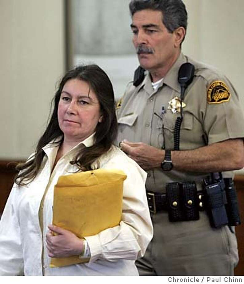 Jimena Barreto, left, is led into the courtroom before the morning session on the second day of testimony in her trial Tuesday, April 19, 2005, in Martinez, Calif. Barreto, 46, faces 30 years to life in prison if convicted of second-degree murder, vehicular manslaughter while intoxicated, leaving the scene of a crime, possession of cocaine and felony hit-and-run in the deaths of Troy and Alana Pack, who were killed while going out for ice cream with their mother and friends on Oct. 26, 2003. (AP Photo/Paul Chinn, Pool) Photo: PAUL CHINN