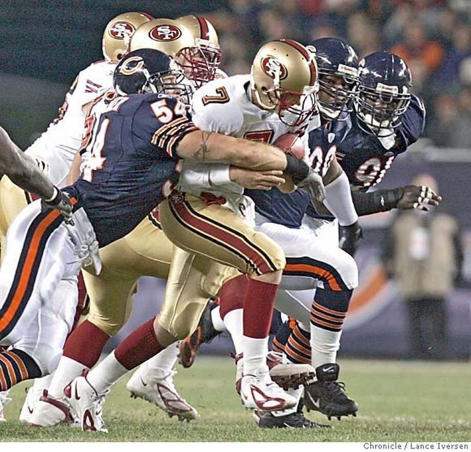 49ers_193.jpg_  Bears #54 Brian Urlacher sacks niners #7 Ken Dorsey for the second time in the first half. San Francisco 49ers vs. The Chicago Bears. By Lance Iversen/San Francisco Chronicle Photo: Lance Iversen