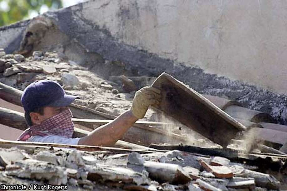 Home owners in the City of Colima save any of building material that they can in order to rebuild .this guy is uplling down roof tiles.  The city of Colima where on Tuesday night a 7.8 earthquake was centered .Photo By Kurt Rogers Photo: Kurt Rogers