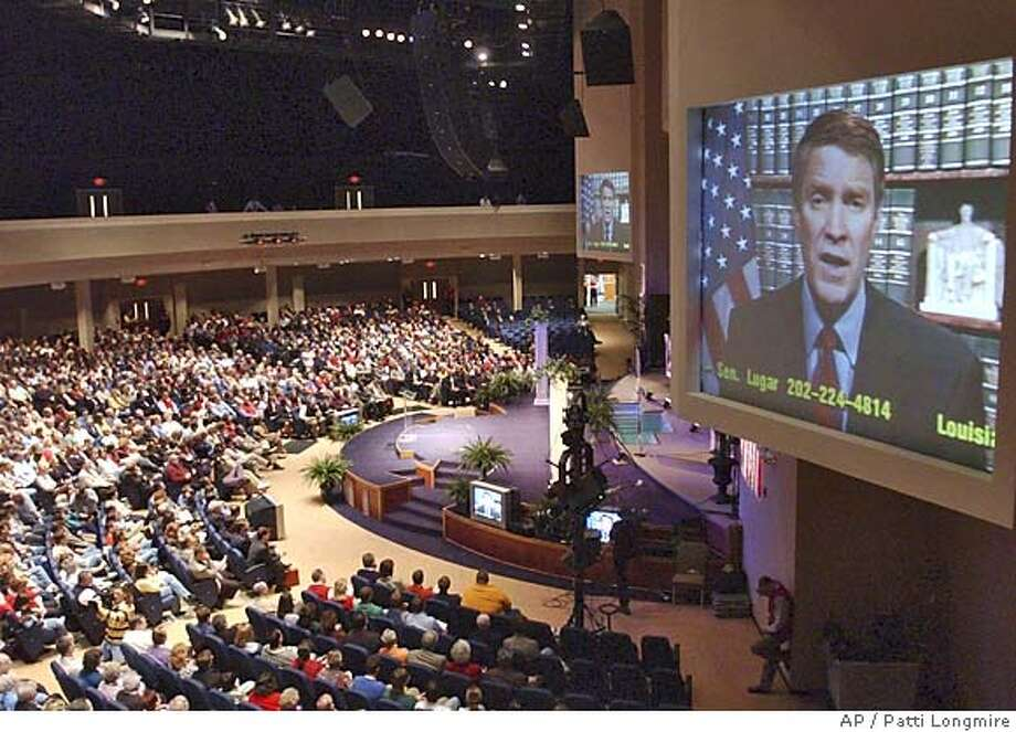 Sen. Bill Frist, R-TN, talks to a crowd about the Republican Filibuster issue via teleconferencing Sunday, April 24, 2005 in Louisville, Ky.. (AP Photo/Patti Longmire) Photo: PATTI LONGMIRE