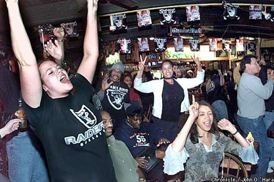 Rickys Sports Bar, Hesperian Blvd. San Leandro  The raiders socoring in the fourth quarter and win was responded by Mercedes Olsen (left) and Rene' Barrow (right) as well as everyone else in the bar. Rickys restricted the amount of people alllowed in to seating only. This way giving people a place to move around and cheer and celebrate.  Photo/John O'hara