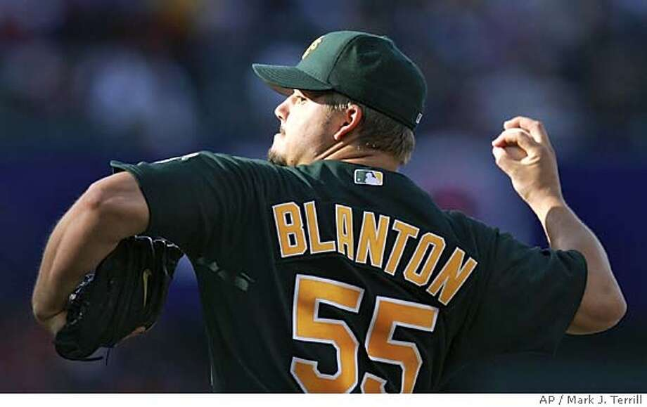 Oakland Athletics pitcher Joe Blanton throws to the plate during the second inning against the Los Angeles Angels, Sunday, April 24, 2004 in Anaheim, Calif. (AP Photo/Mark J. Terrill) Photo: MARK J. TERRILL