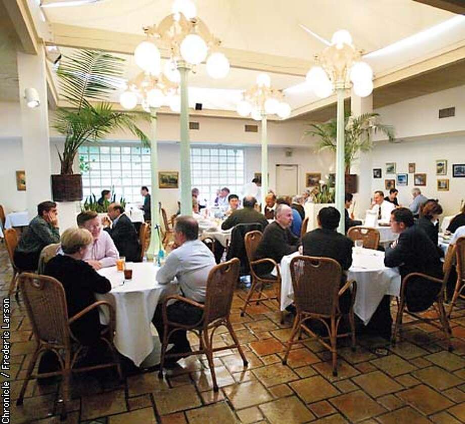 LIONXX-C-13JAN03-BU-FRL: For the last two decades, the Lion and Compass has been a popular lunch spot for Silicon Valley executives. This is where they hung out and even made a deal or two. Valley icons such as Jerry Sanders and Andy Grove were regulars and still stop by from time to time. Sure, the times have changed, but the restaurant's reputation still remains as one of the top choices for business lunches here in the Valley. CO-OWNER ROBERT NINO, THE BROTHER-IN-LAW OF ATARI FOUNDER NOLAN BUSHNELL over looks the restaurant. Chronicle photo by Frederic Photo: FREDERIC LARSON