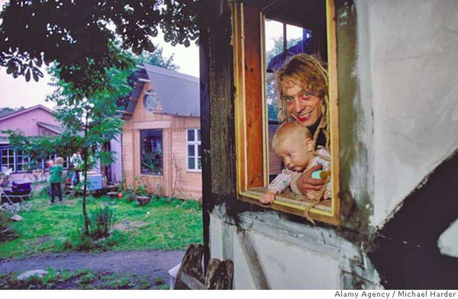 "DENMARK - Father and son - citizens of ""The Free City"" - Christiania photo by Michael Harder/ Alamy Agency  one- time use"