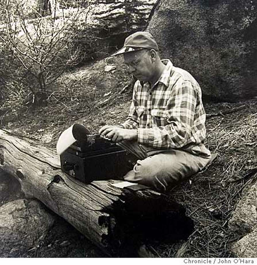 Outdoors writer Ed Neal, with typewriter at hand in the mid-1950s along the John Muir Trail, was proud that he had hiked its length. Photo courtesy of the Neal family