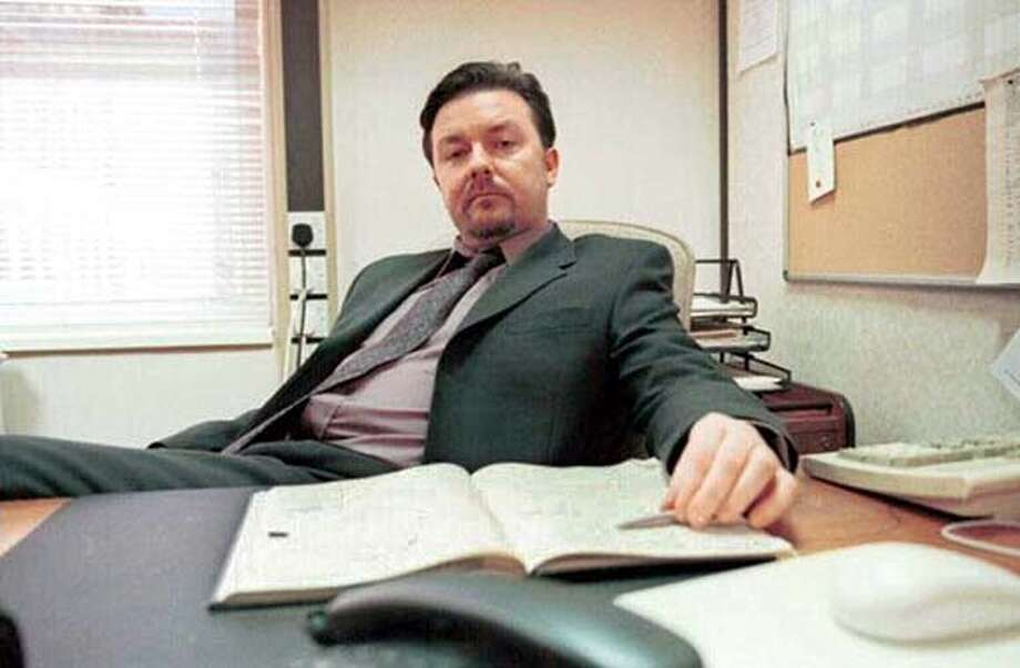 "Ricky Gervais writes, directs and stars as middle manager David Brent in ""The Office."""