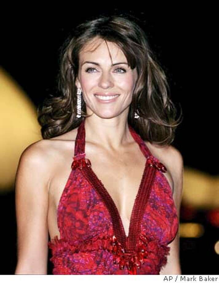 British model and movie star Elizabeth Hurley poses for photographers with the Sydney Opera House as a backdrop in Sydney, Thursday, Oct. 28, 2004. Hurley is in Sydney for 36 hours to support Breast Cancer Awareness month and help raise funds for the National Breast Cancer Foundation. (AP Photo/Mark Baker) Photo: MARK BAKER