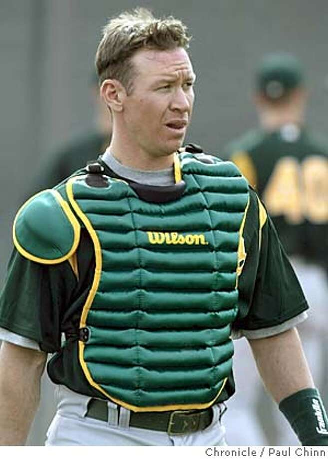 athletics23_235_pc.JPG Damian Miller replaces Ramon Hernandez behind the plate for the A's. The Oakland Athletics opens its 2004 Spring Training camp on 2/22/04 in Phoenix, AZ. PAUL CHINN / The Chronicle Catcher Damian Miller is learning to stay in sync with the A's Big Three. Catcher Damian Miller is learning to stay in sync with the A's Big Three. MANDATORY CREDIT FOR PHOTOG AND SF CHRONICLE/ -MAGS OUT Sports#Sports#Chronicle#11/2/2004#ALL#5star##0421633852 Photo: PAUL CHINN