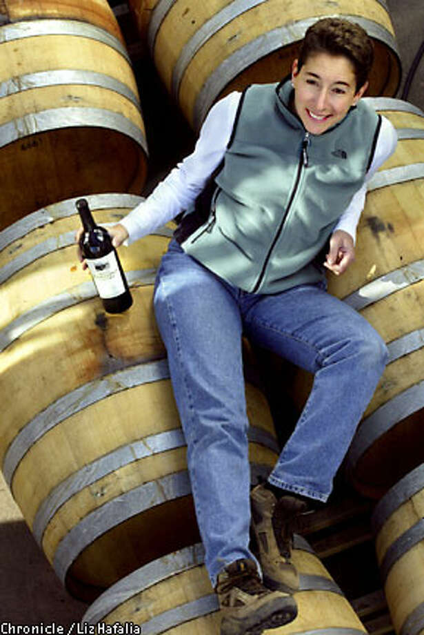 Out of the Barrel: Susan Pey of shows off a bottle of her Merlot made from grapes grown in Marin. Chronicle photo by Liz Hafalia