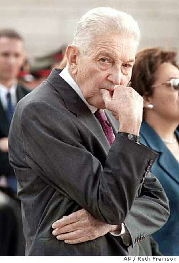 Israeli President Ezer Weizman listens as Romanian President Emil Constantinescu makes remarks at a welcoming ceremony for him at the President's residence in Jerusalem Monday, Jan. 3, 2000. On Sunday Israel's state prosecutor asked Weizman to turn over documents detailing nearly half a million dollars received from a French millionaire while Weizman was a civil servant. Weizman has admitted receiving $450,000 from Edouard Sarousi but said the money was a gift from a family friend who had no interests in Israel, and that the law did not require him to report or pay taxes on it. (AP Photo/Ruth Fremson) Ran on: 04-25-2005  Ezer Weizman in 2000. Photo: RUTH FREMSON