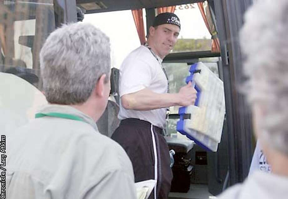 Raiders Bill Romanowski gives away from the media as he boards the team bus for practice with his case of meds and vitamins, at the hotel in LaJolla, Wed. Jan22,03.  SAN FRANCISCO CHRONICLE/LACY ATKINS Photo: LACY ATKINS