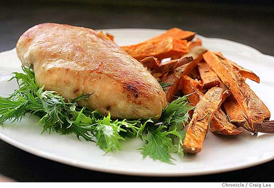 WORKING27_043_cl.JPG  Working Cook column recipe. Photo of pan-roasted chicken with sweet potato fries. Food photo styled by Caroline Pagel.  Event on 10/20/04 in San Francisco. Craig Lee / The Chronicle MANDATORY CREDIT FOR PHOTOG AND SF CHRONICLE/ -MAGS OUT Food#Food#Chronicle#10/27/2004#ALL#Advance##0422421961 Photo: Craig Lee