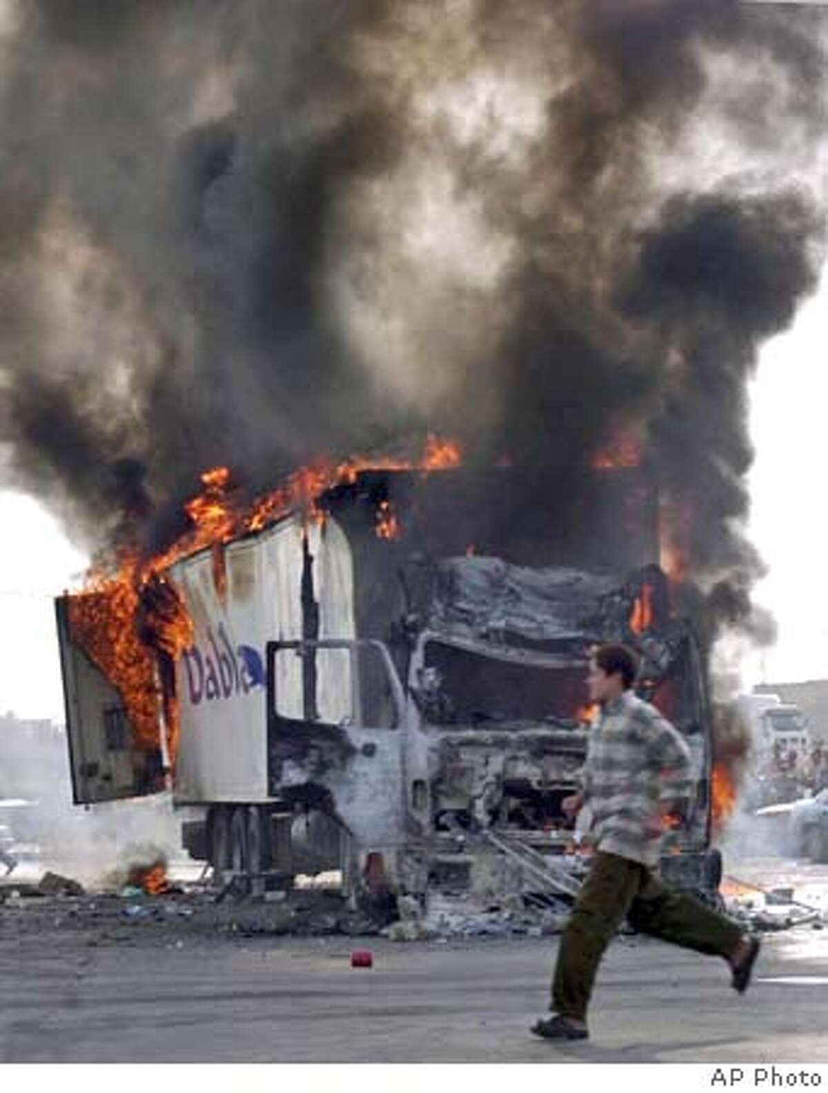 A Turkish truck burns after insurgents opened fire on it while it was carrying bottled water in the northern city of Mosul, Iraq Friday, Oct. 29, 2004. The driver was killed, according to Iraqi police.(AP Photo)