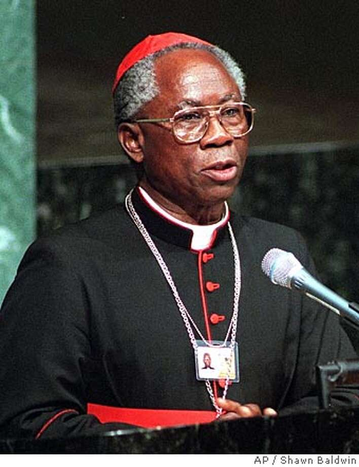 ** FILE ** Cardinal Francis Arinze, president of the Vatican's Pontifical Council for Interreligious Dialogue, delivers Pope John Paul II's message at the Millennium World Peace Summit Tuesday, Aug. 29, 2000, at the United Nations. Pope John Paul II chose Nigeria's most powerful cleric, Cardinal Francis Arinze, to lead the church's rapprochement with other religions at a time when fundamentalist Islamic and Protestant sects replaced communism as the biggest challenge to Catholic proselytizing. (AP Photo/Shawn Baldwin) FILE PHOTO FROM AUG. 29, 2000 Photo: SHAWN BALDWIN