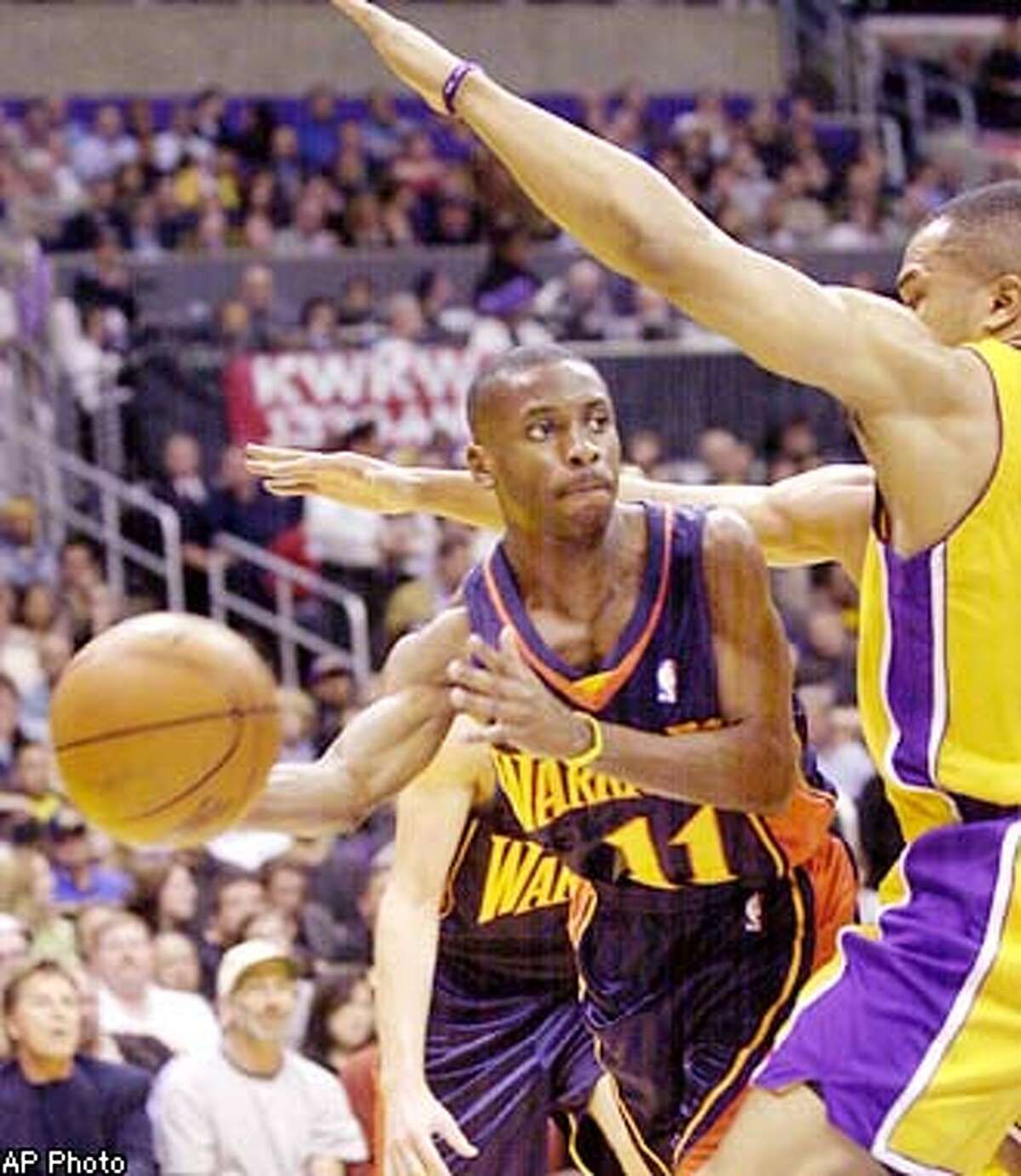 Los Angeles Lakers' Derek Fisher, right, tries to trap Golden State Warriors' Earl Boykins during the second quarter Wednesday, Jan. 22, 2003, in Los Angeles. (AP Photo)