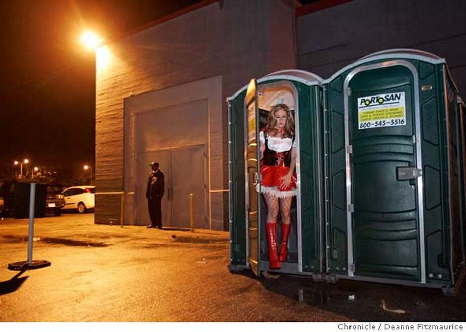 exoticball_099_df.JPG  Attendees use the portapotties while waiting in the long line to get inside. The 25th annual Exotic Erotic Ball took place at the Cow Palace.  Deanne Fitzmaurice / The Chronicle MANDATORY CREDIT FOR PHOTOG AND SF CHRONICLE/ -MAGS OUT Datebook#Datebook#Chronicle#10/27/2004#ALL#Advance##0422431874 Photo: Deanne Fitzmaurice