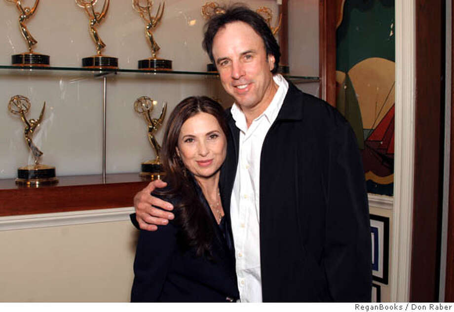 "(NYT68) LOS ANGELES -- April 11, 2005 -- BOOKS-HOLLYWOOD -- Judith Regan and Kevin Nealon from ""Saturday Night Live,"" at a book party for authors based in Los Angeles, March 31, 2005. Regan, whose ReganBooks imprint has produced a string of celebrity-driven and highly profitable bestsellers from authors as diverse as Gen. Tommy Franks and the filmmaker Michael Moore, is planning to move her publishing and media group to Los Angeles by the end of the year to spend more time on television and film projects, she said. In doing so, ReganBooks, which is part of HarperCollins, which is in turn owned by Rupert Murdoch's News Corporation, would be one of the few major book imprints to be based outside Manhattan and one of the first to leave New York for the West Coast. (Don Raber/ReganBooks/The New York Times) XNYZ Photo: Don Raber/ReganBooks"