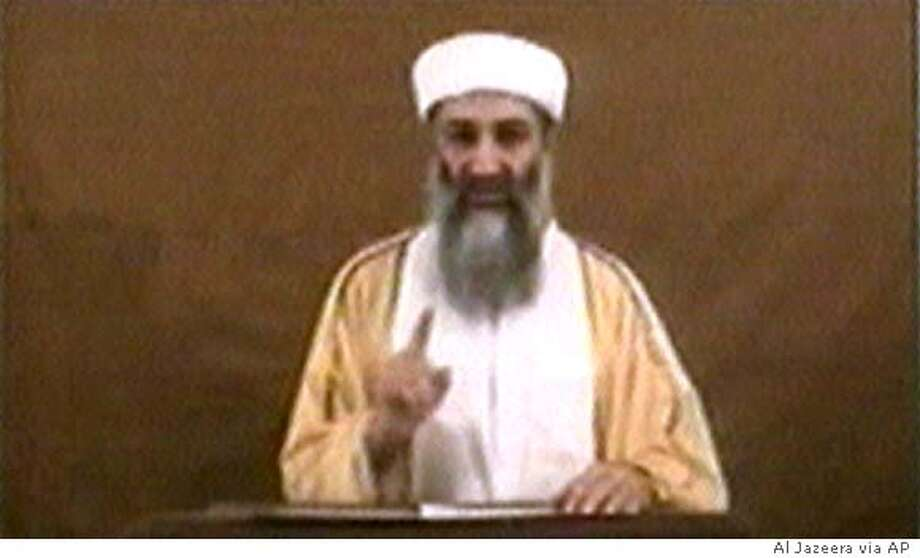"Osama bin Laden speaks in this image made from an undated video broadcast on Friday, Oct. 29, 2004 by Arab television station Al-Jazeera. In the statement, bin Laden directly admitted for the first time that he carried out the Sept. 11 attacks, and said ""the best way to avoid another Manhattan"" was to stop threatening Muslims' security. Al-Jazeera, based in Qatar, did not say how it had received the tape. (AP Photo/AlJazeera via APTN) ** TV OUT **"