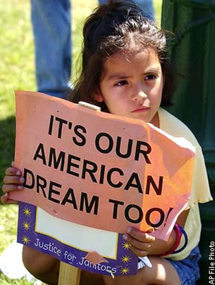 ** FILE ** Vianney Rubio, 5, of Santa Ana, Calif., holds a sign at a rally held to protest the arrests of Hispanic immigrant workers at Southern California airports, Aug. 23, 2002, in Santa Ana. Hispanics have surpassed blacks as the nation's largest minority group, the Census Bureau said Tuesday, Jan. 21, 2003. The Latino population grew to 37 million in July 2001, up 4.7 percent from April 2000. The black population increased 2 percent during the same period, to 36.1 million. (AP Photo/Lucy Nicholson, File) Photo: LUCY NICHOLSON