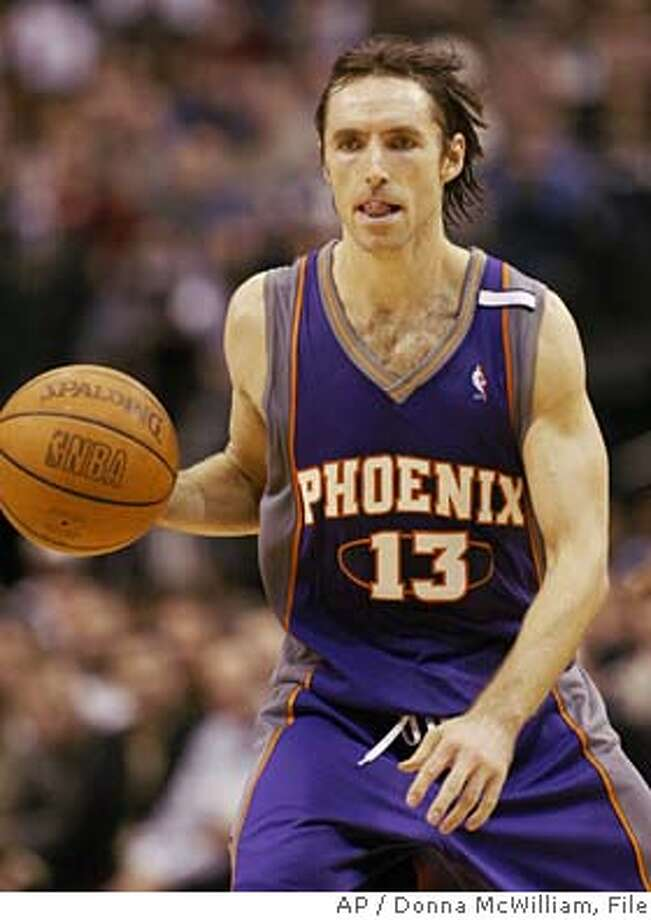 Former Dallas Mavericks guard and current Phoenix Suns guard Steve Nash, from Canada, moves the ball downcourt in the fourth quarter of their game in Dallas, Tuesday, Nov. 16, 2004. This was the first time Nash has played in Dallas since going to the Suns. The Suns won, 107-101. (AP Photo/Donna McWilliam) Ran on: 12-05-2004  Steve Nash was recently named the West's Player of the Month. Ran on: 12-05-2004  Steve Nash recently was named the West's Player of the Month. Ran on: 12-05-2004  Steve Nash recently was named the West's Player of the Month. Ran on: 12-05-2004 Photo: DONNA MCWILLIAM