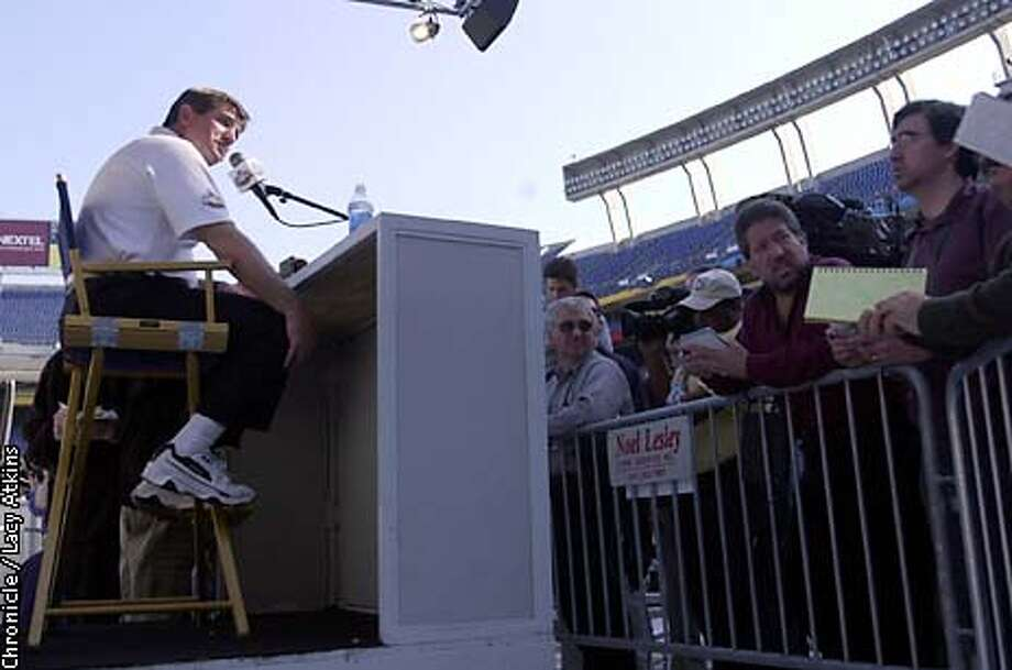 Raiders head coach Bill Callahan, sits in a director chair that is to tall for his feet to touch the ground as he answers questions during the Raiders Media Day, Tuesday Jan.21,03, in San Diego.  SAN FRANCISCO CHRONICLE/LACY ATKINS Photo: LACY ATKINS