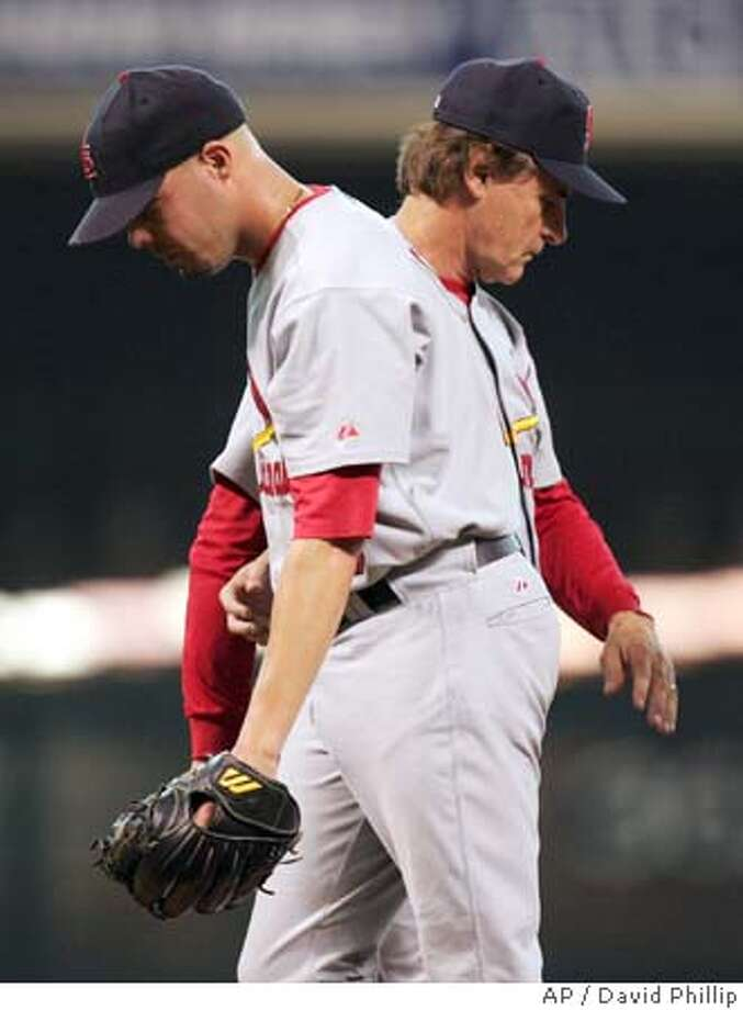 St. Louis Cardinals manager Tony LaRussa, rear, removes pitcher Kiko Calero in the sixth inning against the Houston Astros during Game 4 of the National League Championship Series in Houston, Sunday Oct. 17, 2004. (AP Photo/David Phillip) Sports#Sports#Chronicle#10/30/2004#ALL#5star#D2#0422418481 Photo: DAVID J. PHILLIP