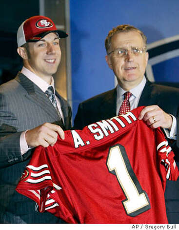 Utah quarterback Alex Smith, left, holds up a San Francisco 49ers jersey with NFL commissioner Paul Tagliabue after the 49ers selected him as the No. 1 overall pick in the NFL Draft in New York Saturday, April 23, 2005. Photo: GREGORY BULL