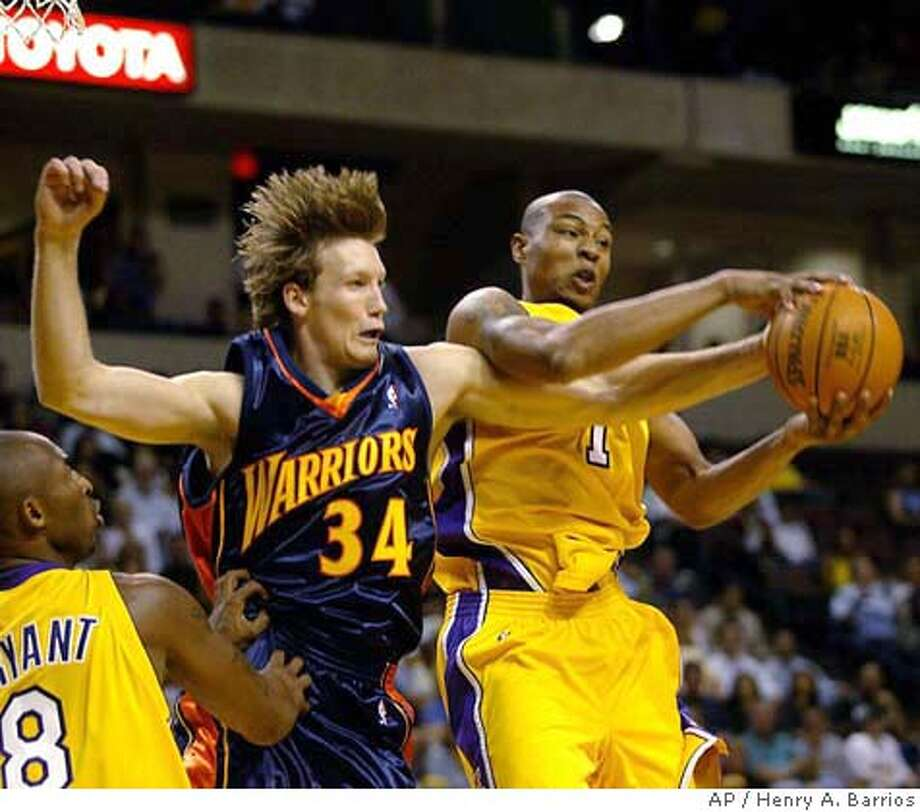 Los Angeles Laker's Caron Butler, right, comes down with a rebound in front of Golden State Warrior's Mike Dunleavy (34) during a preseason game Sunday, Oct. 17, 2004, in Bakersfield, Calif. Laker's Kobe Bryant is at left. (AP Photo/The Bakersfield Californian, Henry A. Barrios) ** MANDATORY CREDIT ** MAGS OUT, , TV OUT, ONLINE OUT, MADATORY CREDIT Sports#Sports#Chronicle#10/25/2004#ALL#5star##0422418932 Photo: HENRY A. BARRIOS