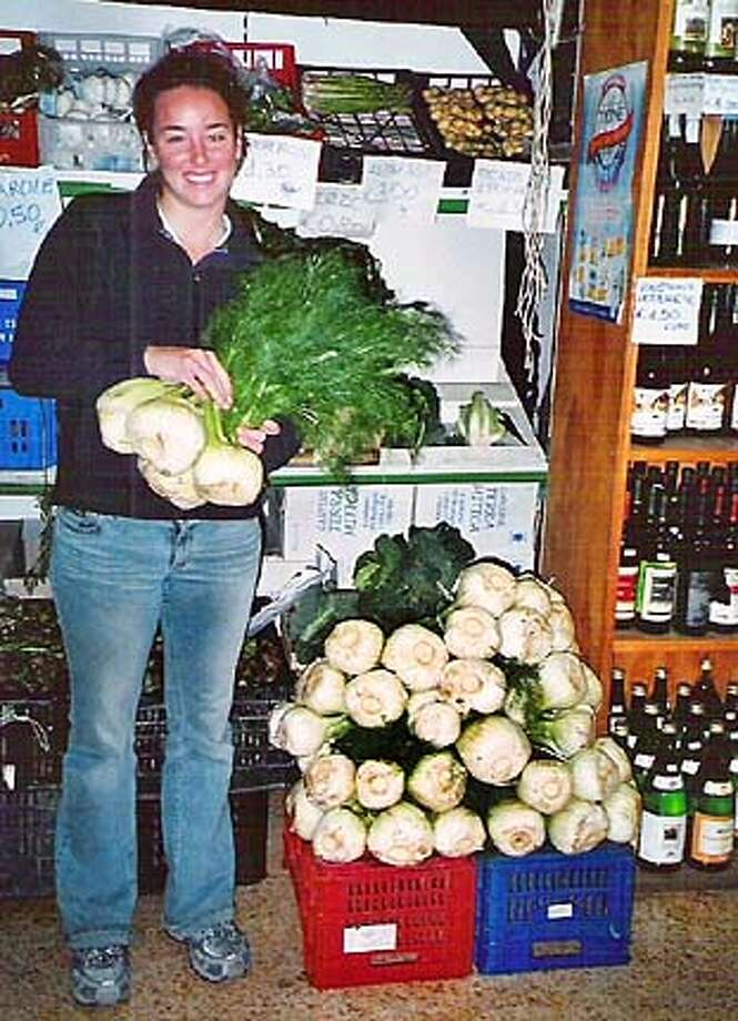 PLANT FENNEL2.JPG Greg Coppa's daughter hefting finnochio in Sorrento. HANDOUT