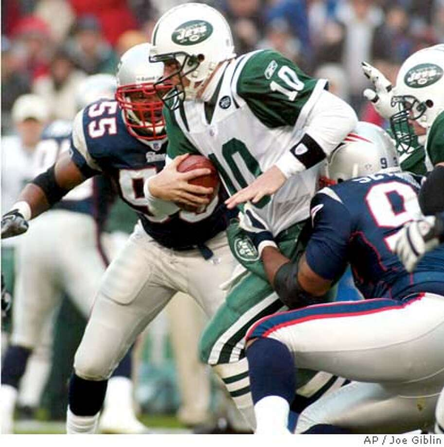 New York Jets quarterback Chad Pennington (10) is caught by New England Patriots' Richard Seymour as the Patriots as Willie McGinest (55) moves in to help on the tackle during first half action in Foxboro, Mass., Sunday, Oct. 24, 2004. (AP Photo/Joe Giblin) Sports#Sports#Chronicle#10/25/2004#ALL#5star##0422430215 Photo: JOE GIBLIN
