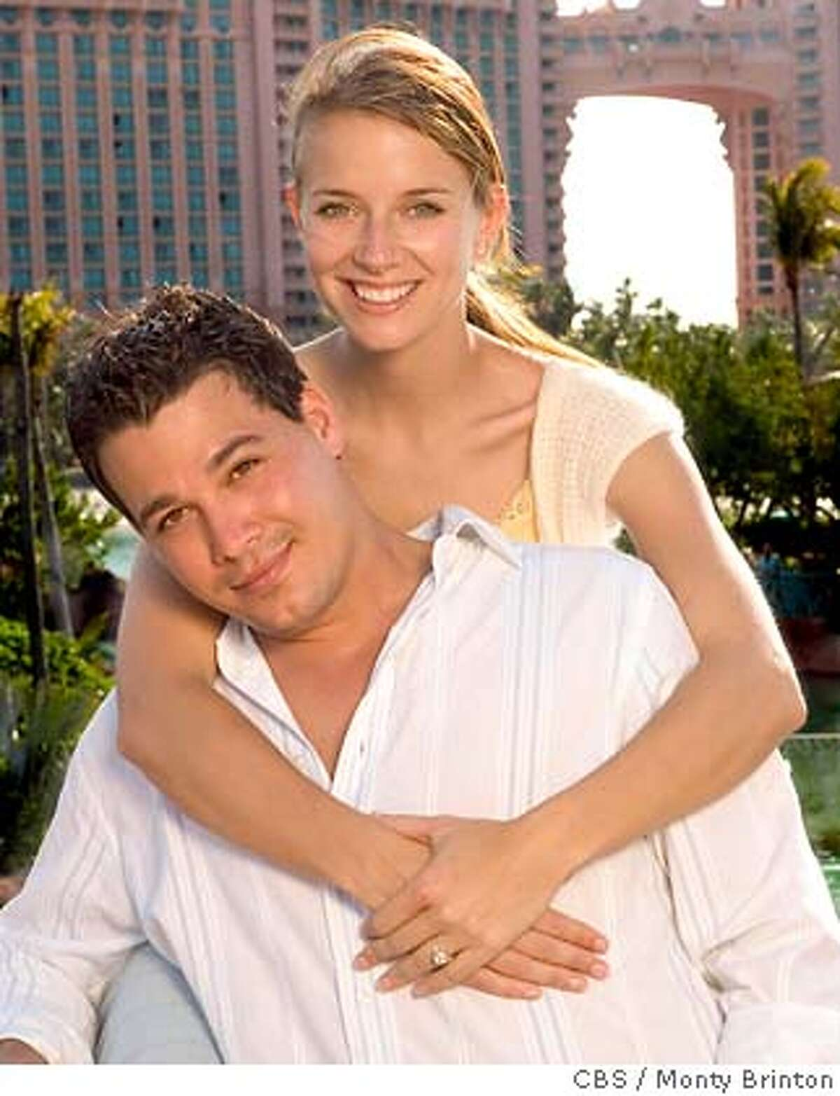 In this undated photograph released by CBS Tuesday, April 19, 2005, Survivor and Amazing Races Rob Mariano and Amber Brkich pose for a portrait at Atlantis, Paradise Island in The Bahamas. A two-hour prime-time special on the wedding of Rob Mariano and Amber Brkich, who were wed in the Bahamas Saturday, will air May 24, 2005. (AP Photo/CBS, Monty Brinton)