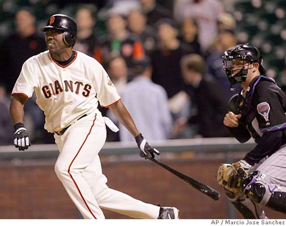 San Francisco Giants' Deivi Cruz, left, hits a bases-loaded single off Arizona Diamondbacks reliever MIke Gosling to win the game in the 13th inning on Thursday, April 21, 2005 in San Francisco. San Francisco won 4-3. (AP Photo/Marcio Jose Sanchez) Photo: MARCIO JOSE SANCHEZ