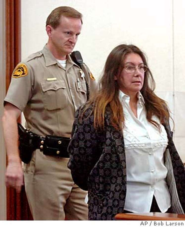 Jimena Barreto is escorted into the courtroom for jury selection at her trial in Contra Costa County court in Martinez, Calif., Monday, April 11, 2005. Barreto, 46, faces 30 years to life if convicted of second-degree murder, vehicular manslaughter while intoxicated, leaving the scene of a crime, possession of cocaine and felony hit-and-run in the deaths of Troy and Alana Pack, who were killed while going out for ice cream with their mother and friends on Oct. 26, 2003. (AP Photo/Bob Larson, pool) POOL PHOTO Photo: BOB LARSON