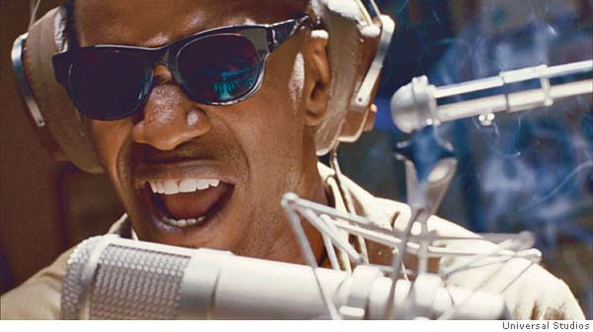 JAMIE FOXX as American legend Ray Charles in the musical biographical drama, Ray.