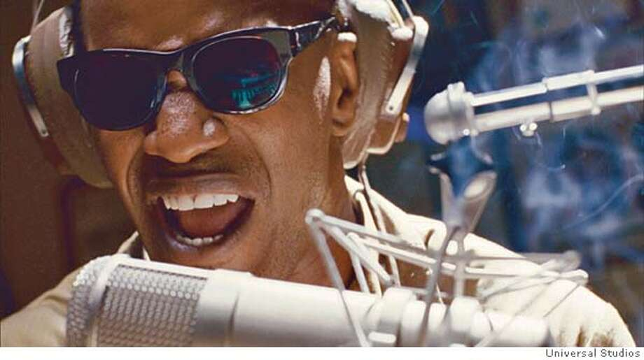 JAMIE FOXX as American legend Ray Charles in the musical biographical drama, Ray. Photo: Credit: Universal Studios