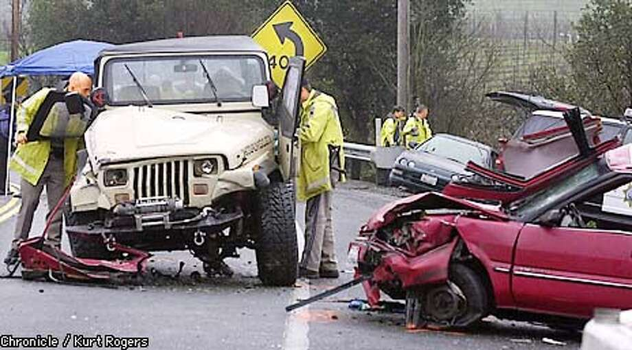 CHP officers investigate a Car accident on HWY 121 between Napa and Sonoma. That left two injured and four dead. The three car accident started when the red car on the right went over the center divider and side swiped the black car in the backgroung then hitting the Jeep head on. the four in the Red Car were killed .Photo by Kurt Rogers Photo: Kurt Rogers