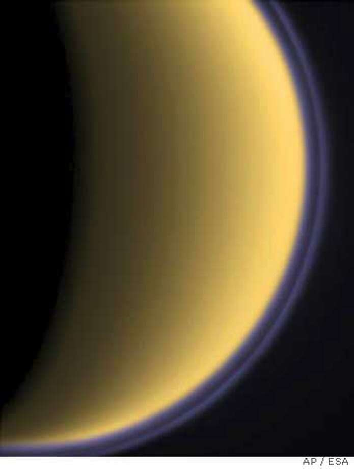Purple haze is seen around the Saturn moon Titan on Tuesday, Oct. 26, 2004 as the international Cassini spacecraft makes a fly-by of Saturn's largest moon - the closest ever performed. Data from the fly-by was transmitted by the spacecraft early Wednesday, Oct. 27, 2004( AP Photo/ EUROPEAN SPACE AGENCY ESA) ** FOR EDITORIAL USE ONLY MANDATORY CREDIT: EUROPEAN SPACE AGENCY ESA **