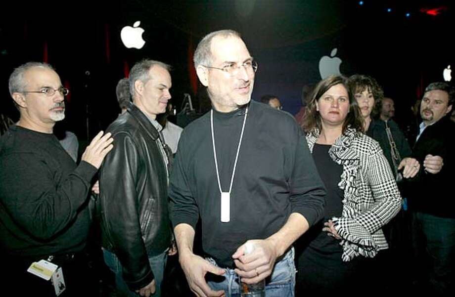 macworld12_168_pc.jpg  Steve Jobs, wearing his new iPod Shuffle around his neck, was treated like royalty as worked the crowd after his keynote speech. Apple CEO Steve Jobs unveiled the new Mac Mini desktop computer and the iPod Shuffle during his keynote speech at the 2005 Macworld show on 1/11/05 in San Francisco, CA.  PAUL CHINN/The Chronicle MANDATORY CREDIT FOR PHOTOG AND S.F. CHRONICLE/ - MAGS OUT Photo: PAUL CHINN