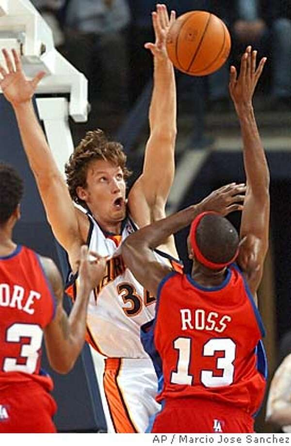 Golden State Warriors' Mike Dunleavy, middle, blocks a shot by Los Angeles Clippers' Quinton Ross (13) during the first half of a preseason game Wednesday, Oct. 27, 2004, in Oakland, Calif. (AP Photo/Marcio Jose Sanchez) Sports#Sports#Chronicle#10/28/2004#ALL#5star##0422436395 Photo: MARCIO JOSE SANCHEZ