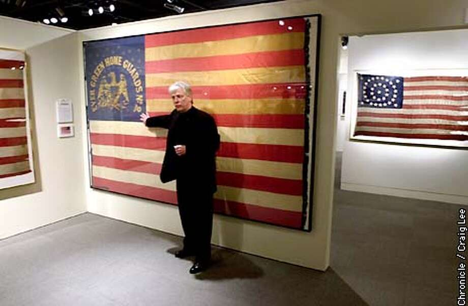 Historic flag collection exhibition at the Presidio Officers Club. Photo of Ben Zaricor, owner of many of these flags, stands next to a California U.S. Militia flag, 1860-61. It belonged to the Evergreen Home Guard #2, an area in the present day Silicon Valley. Flag to the far right in the background, is a 35-star U.S. flag, 1863-65.  Photo by Craig Lee/San Francisco Chronicle Photo: CRAIG LEE