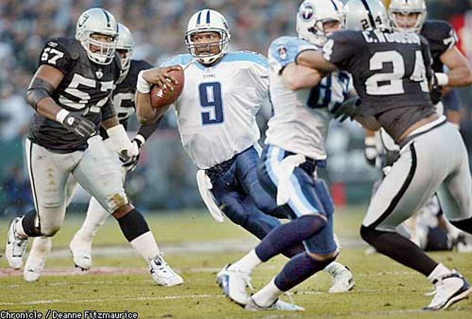 Titans quarterback Steve McNair weaves his way through the Raiders for a second quarter first down.Raiders against the Tennessee Titans in AFC championship game. BY DEANNE FITZMAURICE/CHRONICLE Photo: BRANT WARD