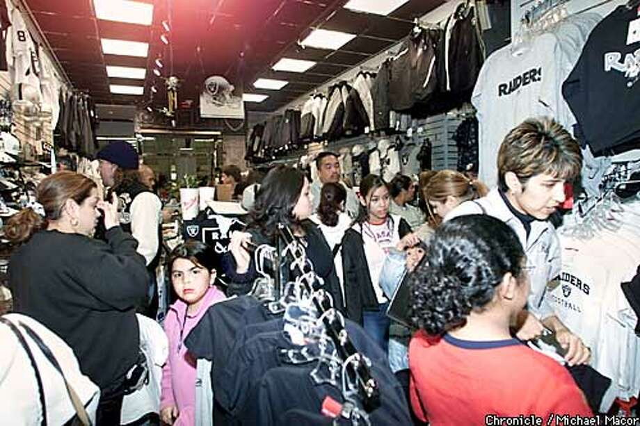 "RAIDERS5-C-20JAN03-MT-  Sacramento, Arden Fair Shopping Center. ""The Raider Image"".  A viewfrom the back of the shop looking out. A constant crowd flowed through the small store on the second flor of the Mall"