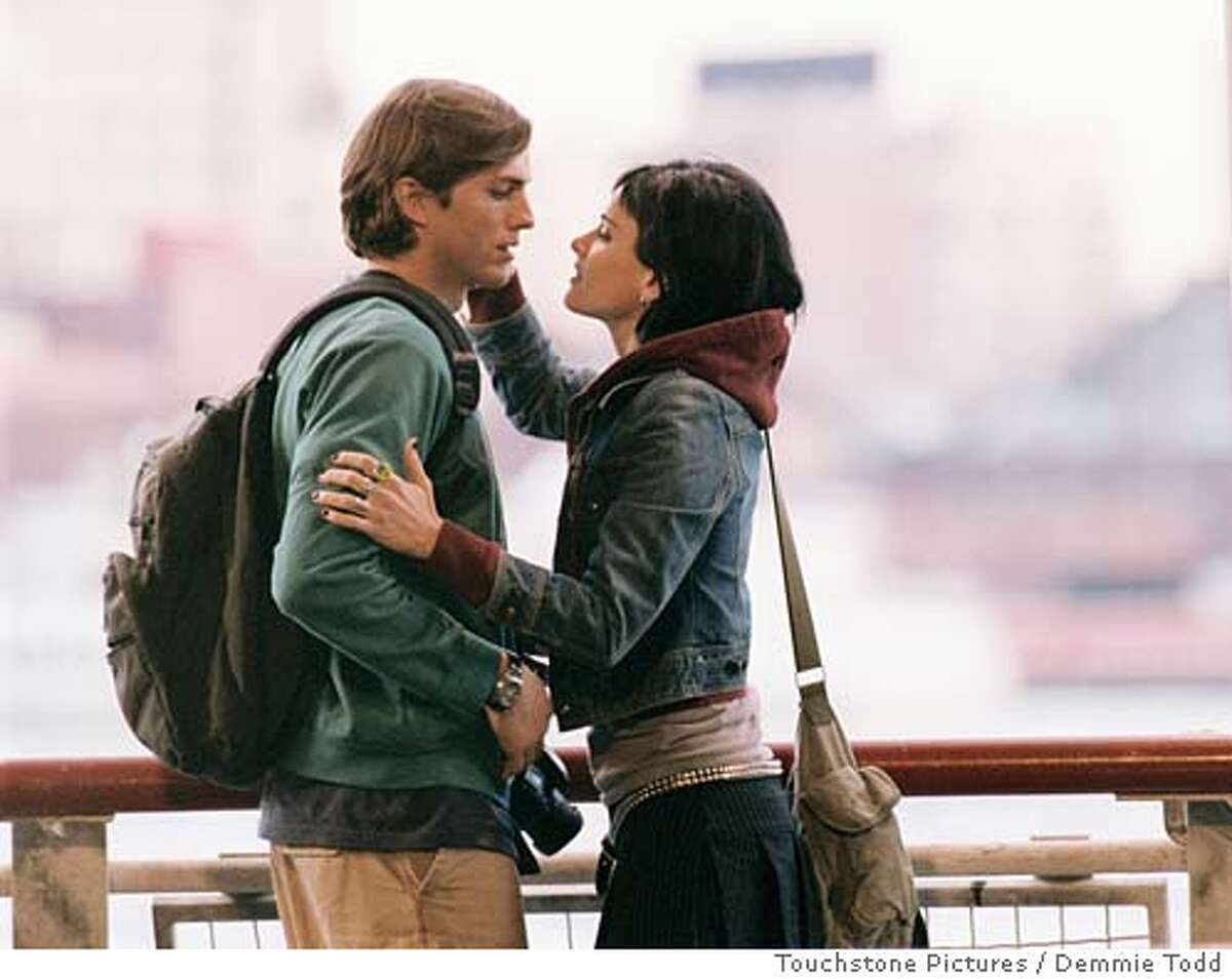 """In this photo provided by Touchstone Pictures, Oliver (Ashton Kutcher) and Emily (Amanda Peet), are good friends until they realize they may just be right for each other romantically in """"A Lot Like Love."""" (Touchstone Pictures/Demmie Todd)"""