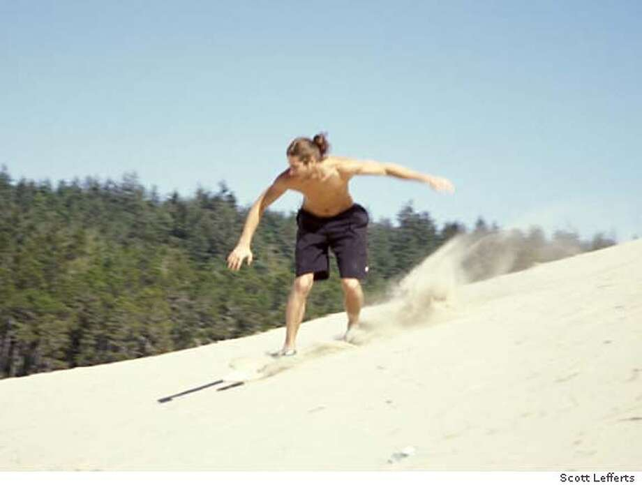TRAVEL OREGON SANDBOARD -- Abel, a snowboarder from Eugene, tries sandboarding for the first time. CREDIT: Scott Lefferts Travel#Travel#Chronicle#10/24/2004#ALL#Advance#D5#0422421346 Photo: Scott Lefferts