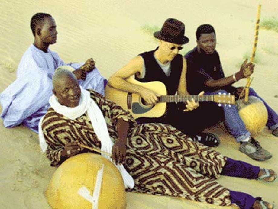 Musicians and their instruments, left to right: Hassi Sare (holding the njarka); Hamma Sankare (foreground, with the calabash); Markus James (guitar); Solo Sidibe (with the kamele n'goni, a kind of gourd harp).